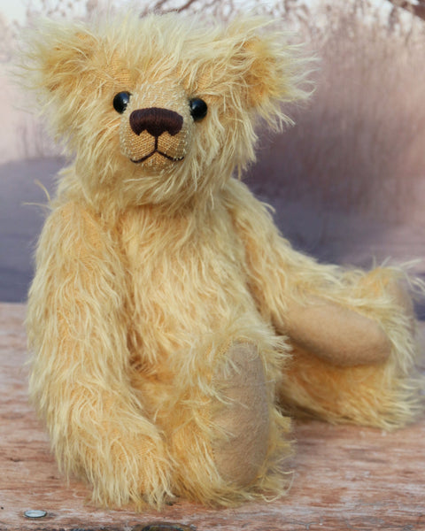 Marigold's Teddy a lovable sweet traditional artist teddy bear made from beautiful gold German mohair by Barbara-Ann Bears Marigold's Teddy comes from the same design as we used to make Marigold's teddy bear for Downton Abbey Marigold's Teddy stands 11 inches (28cm) tall and is 8 inches (20cm) sitting.