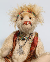 Marylou, a happy and very lovable hippy bear, a one of a kind, mohair, artist bear by Barbara-Ann Bears, she stands 13.5 inches(34 cm) tall and is 9.5 inches ( 24 cm) sitting. Marylou is made in medium length pale beige mohair, the top of her head and the backs of her ears are a longer, twirly strawberry-blond mohair