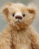Matthew is a charming and traditional mohair artist bear by Barbara Ann Bears of the same design as the teddy bear we made for Downton Abbey.  He stands 10.5 inches/27 cm tall and is 8.5 inches/22 cm sitting and is made from  beautiful, wavy, fairly long beige coloured German mohair