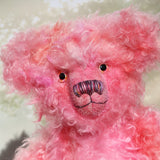 Maude is made from a wonderful, long and fluffy mohair which Barbara has dyed in many pretty shades of pink. Maude has subtly hand-dyed pink velvet felt paw pads and gorgeous hand painted glass eyes, she has a splendid, carefully embroidered nose and a relaxed and demure expression.