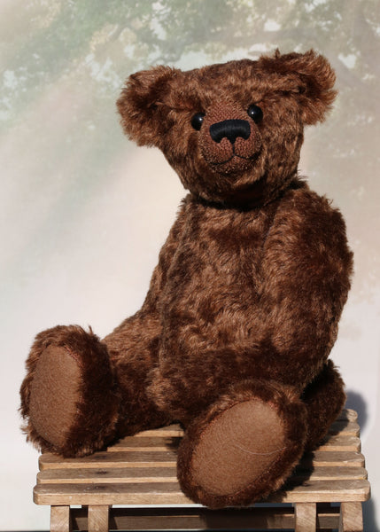 McPherson is a sweet and handsome, traditional teddy bear made from wonderful soft chocolate brown German mohair by Barbara Ann Bears. He is 16 inches (41cm) tall and is 11 inches (28cm) sitting. McPherson is made from a gorgeous, dense and soft, very slight distressed, delicious, warm chocolatey brown German mohair