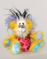 Mickey Gigglefitz is a wonderfully happy and colourful one of a kind artist teddy bear by Barbara-Ann Bears he stands 7.5 inches( 19 cm) tall  Mickey Gigglefitz is mostly made from a distressed hand dyed yellow mohair His face is a long white mohair, black-spotted pink faux fur and plumes of very long black faux fur