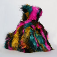 Milton is mostly made from a very long, shaggy and dense faux fur which is black with bands of magenta, mustard and cyan