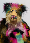 Milton is a very shaggy, wild and colourful, one of a kind, artist teddy bear by Barbara-Ann Bears, he stands 19 inches (48 cm) tall and is 15 inches (38 cm) sitting. Milton is  made from a black magenta, mustard and cyan dense faux fur and very long mohairs in soft golden blond (face), rose pink(tummy) and black (ears)