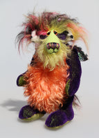 Mister Oofaloosy is a wild yet gentle and not so fiery, one of a kind artist honey dragon  by Barbara Ann Bears, he stands 10 inches( 25 cm) tall and is 8 inches (20 cm) sitting. Mister Oofaloosy is made from short purple mohair, long hand dyed mohair in lime, green and yellow and long, pink black and yellow faux fur