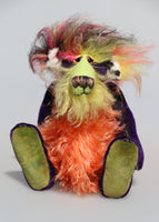 Mister Oofaloosy is mostly made from a very short purple mohair with a lime backcloth, his face is a very long and fluffy mohair that Barbara has hand dyed lime green, his tummy is a similar mohair hand dyed a slightly subdued orange, the underside of his tail is again a similar mohair this time dyed a lemony yellow and the top of his head, the back of his ears and the top of his tail are a very long black, pink and yellow faux fur. Mister Oofaloosy has hand dyed green velvet paw pads