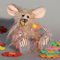 Molly is a comical, sweet and dinky, one of a kind, artist mouse in hand dyed mohair by Barbara-Ann Bears, she's definitely not a vole Molly stands just 5 inches (12.5 cm) tall and is 4 inches (10 cm) sitting, her tail is 5.5 inches (13 cm) long. Molly is a sweet little mouse, a gentle soul with a long tail, big ears and whiskers.