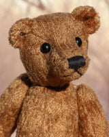 Morgan is a very lovable and sweet, one of a kind, traditional artist teddy bear made from gorgeous vintage mohair by Barbara-Ann Bears. Morgan stands 8.5 inches (21 cm) tall and is 6 inches (15 cm) sitting. Morgan is made from beige vintage German mohair with beige wool felt paw pads and black vintage boot button eyes