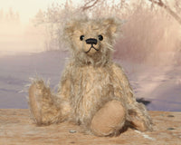 Morris is a very lovable and sweet, one of a kind, traditional artist teddy bear made from gorgeous shaggy mohair by Barbara-Ann Bears. Morris stands 8 inches (20 cm) tall and is 6 inches (15 cm) sitting. Morris is made from beige fluffy German mohair with beige wool felt paw pads and black vintage boot button eyes