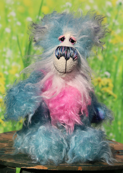 Murff is an extremely happy teddy bear, a comically joyful, one of a kind, hand-dyed mohair artist bear by Barbara-Ann Bears Murff stands 9 inches( 23 cm) tall and is 6.5 inches ( 16 cm) sitting. Murff is a wonderfully happy and enthusiastic teddy bear in blue and pink hand dyed mohair with a stonking nose and huge smile