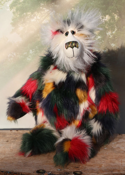 Nathaniel Noon-Doodle is a magnificent, richly colourful one of a kind, artist teddy bear in fabulous faux fur & mohair by Barbara-Ann Bears, he stands 19 inches (48 cm) tall and is 15 inches (38 cm) sitting, Nathaniel is made from faux fur in green, deep red, gold, white and black and very long and fluffy white mohair.