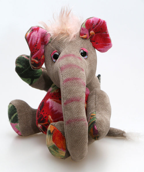 Nellie is a small, friendly and very well behaved, artist elephant made in beautiful chenille, upcycled denim & mohair by Barbara Ann Bears Nellie is number two in an edition of ten, she stands 8 inches( 20 cm) tall, is 6 inches (15 cm) sitting and 4.5 inches (11 cm) across the ears.