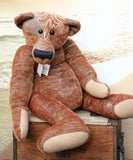 Ole Gravelbelly is a a saggy, loveable and folksy teddy bear made in a beautifully embroidered vintage German mohair by Barbara Ann Bears. Ole Gravelbelly is 21.5 inches (38cm) tall and is 14 inches (35cm) sitting, 12 inches (30cm) slouching. Ole Gravelbelly is a very saggy bear with bucketfuls of character