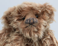 Ormanroyd is a gruff and groovy guy, a veteran artist bear from Barbara-Ann Bears he stands 11.5 inches (29cm) tall and is 8.5 inches (21cm) sitting Ormanroyd was made from beautiful, dense, distressed beige-tipped brown German 'Zotty' mohair. He has brown German wool felt paw pads and green translucent glass eyes