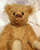 Orville is a very lovable and sweet, one of a kind, traditional artist teddy bear made from gorgeous mohair by Barbara-Ann Bears. Orville stands 8 inches (20 cm) tall and is 6 inches (15 cm) sitting. Orville is made from brown, slightly ginger, distressed German mohair with beige wool felt paw pads and amber glass eyes