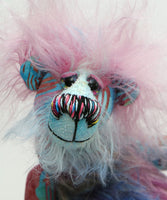 Ozzy is a comically sweet and dinky, one of a kind, artist bear in beautiful printed fabric and hand dyed mohair by Barbara-Ann Bears, he stands just 6.25 inches (16 cm) tall and is 5 inches (12.5 cm) sitting, this doesn't include his beautiful shock of pink hair which adds another 2.5 inches (6.5 cm) to these measurements.