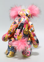 Penelope Cantaloupe is a kooky, funky and pretty one of a kind artist bear in printed cotton, mohair and faux fur by Barbara Ann Bears. Penelope Cantaloupe stands 14 inches( 36 cm) tall and is 9.5 inches (24 cm) sitting. Penelope Cantaloupe is a sweet and artistic bear, very smart in her designer print fabric