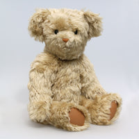 Percy is quite a large bear, he's 22 inches (56 cm) tall and is 16 inches (41 cm) sitting.Percy is made from a beautiful beige, slightly distressed English mohair which reveals a hint of green in certain lights. Percy has tan leather paw pads and vintage boot buttons for eyes