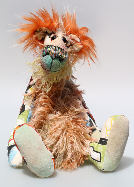 Peter Pickle-Puckle is a kooky, funky and funny one of a kind artist bear in printed cotton, mohair and faux fur by Barbara Ann Bears Peter Pickle-Puckle stands 14.5 inches( 37 cm) tall and is 11 inches (28 cm) sitting, this doesn't include his plumes of wildly fluffy hair on his ears, which add an extra 3.5 inches (9 cm).