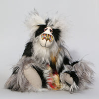 Philip Phillyfaddle is a wildly fluffy and handsome one of a kind artist teddy bear in gorgeous mohair and faux fur by Barbara Ann Bears. Philip Phillyfaddle stands 14.5 inches( 37 cm) tall and is 11.5 inches (29 cm) sitting.