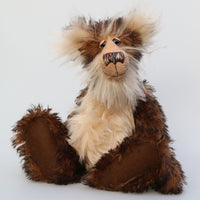 Philoneus Tomsk is a very handsome and dignified, one of a kind, artist bear by Barbara-Ann Bears, he stands 17.5 inches(45 cm) tall and is 13 inches(33 cm) sitting. He is made a long and fluffy, tousled, medium brown mohair with black tipping, contrasting with a fluffy pale cream mohair with a warmer beige backcloth