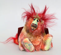 Pinatubo is a very friendly gently colourful and not so fiery one of a kind artist dragon in beautiful hand dyed mohair by Barbara Ann Bears Pinatubo stands 8 inches( 20 cm) tall and is 6.5 inches (16 cm) sitting, this doesn't include his plume of wildly fluffy hair which add an extra 2.5 inches (6 cm).