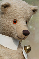 Pomeroy a large and elegant classical, one of a kind, traditional mohair artist teddy bear by Barbara Ann Bears. He stands 23.5 inches (60 cm) tall and is made from gorgeous dense and curly beige mohair with beige suedette paw pads, old amber glass eyes, an impressive embroidered brown nose and the sweetest smile