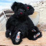 Portia is one of our very old bears, she's a sweet and cuddly, traditional teddy bear by Barbara Ann Bears, she is about 15 inches (38 cm) tall and is 11.5 inches (29cm) sitting. Portia is made from a beautiful, dense and shaggy, straight pile black English mohair her paw pads are made from a decorative cotton fabric