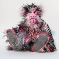 Raphael is a strikingly handsome one of a kind artist teddy bear in gorgeous pink and black mohair and faux fur by Barbara Ann Bears Raphael stands 15.5 inches( 39 cm) tall and is 13 inches (33 cm) sitting. Raphael is a striking bear, a bear of deep pinks, rich silvers and unfathomable black,