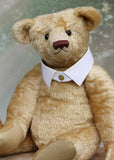 Robin is a large, traditional one of a kind, artist teddy bear in honey gold vintage mohair by Barbara Ann Bears with an Edwardian collar, he stands 21 inches (53 cm) tall and is 15 inches (39 cm) sitting. Robin is made from a beautiful vintage mohair car rug, which we think dates back to the 1920s or 30s