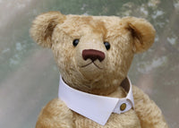 Robin has large beguiling black boot buttons for eyes, a splendid, carefully embroidered brown nose and a relaxed and demure expression.  Robin comes with an Edwardian style shirt collar which is closed with a metal stud and can be removed easily by your valet.