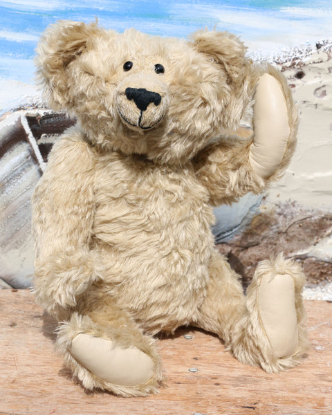 Rory is a very old bear, he was one of our first designs going back to around 1991, he is 15 inches (38cm) tall and is 10.5 inches (27cm) sitting. He is made from blond English mohair and has black glass eyes, leather paw pads and a cheeky smile.