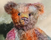 Rowan is a beautiful traditional bear made from delicately coloured hand dyed mohair, he has glass eyes which were painted to match his mohair, a beautiful nose carefully embroidered with individual threads to also match his colouring and a content and gracious expression.