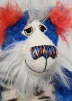 Rudyard Pimpleton has large, beautiful, hand painted eyes with eyelids, a splendid nose embroidered from individual threads to complement his colouring and he has a sweet, friendly smile.