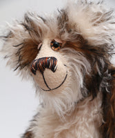 Russel Ruffletoff is a charming and handsome, one of a kind, artist bear by Barbara-Ann Bears in wonderful fluffy tipped mohair Russel Ruffletoff stands 11.5 inches(29 cm) tall and is 9 inches(23 cm) sitting.