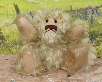 Short 'n Curly is one of our very old bears, he's a sweet and cuddly, traditional teddy bear by Barbara Ann Bears, he stands just 7.5 inches (18 cm) tall and is 5.5 inches (14 cm) sitting. Short 'n Curly is made from a beautiful, distressed, honey blond English mohair with wool felt paw pads and little black glass eyes