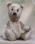 Simon is a sweet and gentle, one of a kind, traditional mohair artist teddy bear, by Barbara-Ann Bears, he stands 9.5 inches (24cm) tall and is 7 inches (18cm) sitting. Simon is made from silver-grey, dense, straight pile German mohair, he has old, black boot button eyes and pale grey German wool felt paw pads