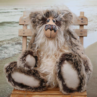 Sir Cadbury Fluffybum is a very sweet and cuddly, one of a kind, artist teddy bear in gorgeous faux fur and mohair by Barbara-Ann Bears. Sir Cadbury Fluffybum stands 14 inches (35 cm) tall and is 11 inches (28 cm) sitting.