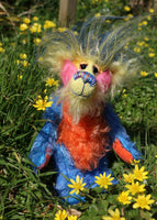 Sparky McTickle is a wild and wonderful bear, full of colourful happiness, a one of a kind, mohair artist teddy bear by Barbara-Ann Bears, he stands 9 inches( 23 cm) tall and is 7 inches ( 18 cm) sitting Sparky McTickle is made from hand-dyed blue, orange, pink and yellow mohair with a long plume of feathery faux fur
