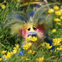 Sparky McTickle has beautiful, hand painted glass eyes with hand coloured eyelids, a splendid nose embroidered from individual threads to compliment his colouring and he has a huge, friendly smile. He loves wild flowers, in our garden he roams about sniffing the celandines