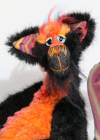 Spooky Norman is very friendly, if fiendishly spooky, one of a kind artist cat in hand-dyed silk, viscose and faux fur by Barbara Ann Bears Spooky Norman stands 12.5 inches( 31 cm) tall and is 11 inches (27 cm) sitting, his curly tail would be about 13 inches (33 cm) long. Spooky Norman is a rather unconventional cat