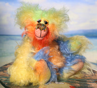 Spritzer is a very happy and sweet teddy bear, a gloriously colourful, one of a kind, hand-dyed mohair artist bear by Barbara-Ann Bears Spritzer stands just 7.5 inches( 19 cm) tall and is 6 inches ( 15 cm) sitting. Spritzer is a mixture of beautiful happy, springtime colours, like pretty flowers and blue skies