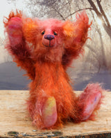 Sprocket is an endearingly comical and undemanding one of a kind artist bear made from hand dyed mohair and faux fur by Barbara Ann Bears, he stands 13 inches( 33 cm) tall and is 10.5 inches (27 cm) sitting. He's mostly made from a long and tousled mohair that Barbara has dyed in purple, pink, peach and orange