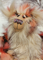 Stanley is the most handsome and endearing, one of a kind, artist bear by Barbara-Ann Bears, he stands 14.5 inches (37 cm) tall and is 11.5 inches (29 cm) sitting. Stanley is made from luxurious long faux furs in rose, cream, peach, pink and black, coupled with a long fluffy blond mohair with a warmer backcloth