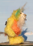 Sunshine is a wonderfully happy and colourful one of a kind mohair artist teddy bear by Barbara-Ann Bears, he stands 8.5 inches(21 cm) tall and is 6 inches (15 cm) sitting. Sunshine is made from several beautiful distressed mohairs hand dyed sunny yellow, orange and blue with a long fluffy white mohair for his face