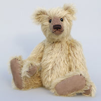 Sven is an elegant and charming, classical, one of a kind, traditional artist teddy bear by Barbara Ann Bears, he stands 14 inches/36cm tall and is 10 inches/26 cm sitting and is made from a beautiful, slightly sparse, fairly long and feathery, straight pile blonde German mohair, with a contrasting mid-brown backing