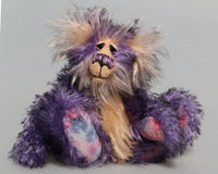 Swizzel is a small, cute and very happy one of a kind artist teddy bear by Barbara-Ann Bears, he stands just 8 inches( 20 cm) tall and is 6 inches ( 15 cm) sitting. He is made from curly black-tipped purple mohair and his face, tummy, the fronts of his ears and the underside of his tail are a long peach coloured mohair