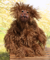 Thingummy Bob is a wild thing, yet a very friendly wild thing, a one of a kind, artist bear by Barbara-Ann Bears in wonderful shaggy mohair, Thingummy Bob stands 10 inches (25 cm) tall and is 7.5 inches (19 cm) sitting. Thingummy Bob is a bear of wonderful woodland colours with the warmest and most loving of personalities.