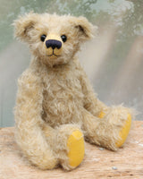 Thomas is a very sweet and charming, one of a kind, traditional artist teddy bear by Barbara Ann Bears. He stands 14 inches/36cm tall and is 10.5 inches/26 cm sitting and is made from a beautiful, distressed, fairly long and fluffy German mohair which is a very pale grey with some black threads woven into it.
