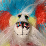 Timmy Tickle Toes has beautiful, hand painted eyes with eyelids, a splendid nose embroidered from individual threads to compliment his colouring and he has a huge, friendly smile.